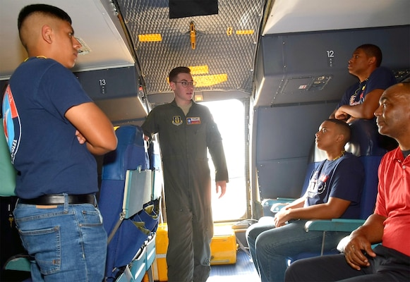 Senior Airman Blake Moore, 68th Airlift Squadron loadmaster, talks about his duties to Benjamin O. Davis High School Air Force Air Force Junior Reserve Officer Training Corps cadets from Aldine, Texas, Feb. 15 at Joint Base San Antonio-Lackland. Moore went on to explain how a loadmaster takes care of cargo and passengers on the aircraft during missions.