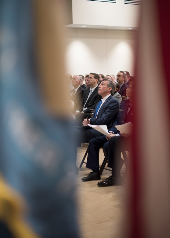 Delaware Governor John Carney watches a Year in Review video during the State of the Guard Event at Joint Force Headquarters, New Castle, Del., Feb. 15, 2019. In addition to the Chambers of Commerce, Gov. Carney attended the event and addressed the attendees by thanking them for supporting the DNG. (U.S. Air National Guard photo by Senior Airman Katherine Miller)
