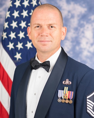 Official photo of MSgt Taylor Armstrong, music director of the Singing Sergeants, The United States Air Force Band, Joint Base Anacostia-Bolling, Washington, D.C.