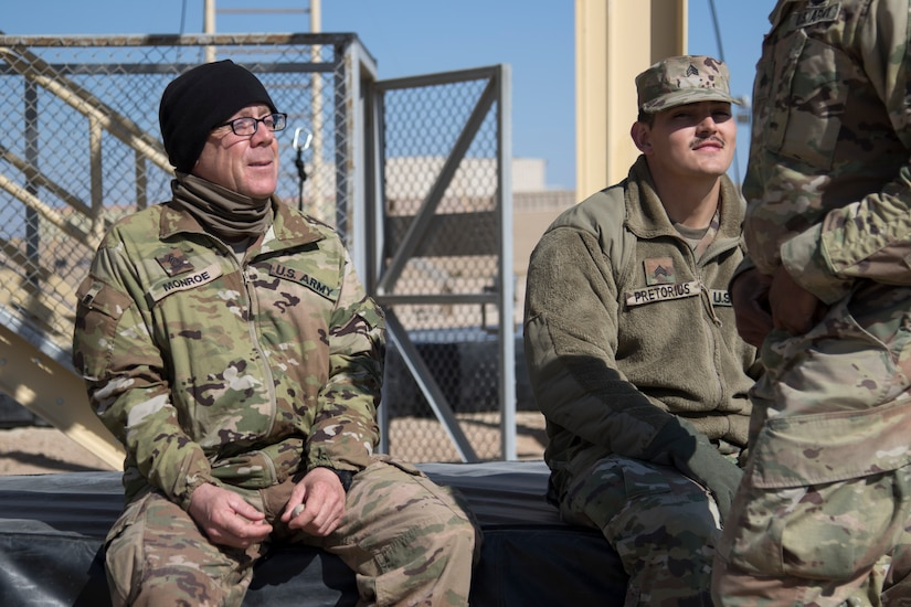 Army Sgt. 1st Class Richard Monroe, a combat medic assigned to the 198th Armored Regiment, Mississippi Army National Guard, chats with Sgt. Michael Pretorius, a combat medic, Kansas Army National Guard, during day seven of Air Assault School's Class 301-19 on Feb. 12, 2019, at Camp Buehring, Kuwait. Soldiers assigned to U.S. Army Central operate in a dynamic environment requiring the right forces in place, including medical support, to respond to crisis or contingencies anywhere in the world.
