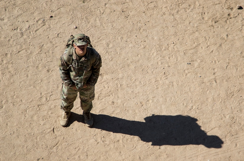United States Army Sgt. Michael Pretorius, a combat medic, Kansas Army National Guard, stands ready to provide medical care to Air Assault students rappelling during day seven of Air Assault School's Class 301-19 on Feb. 12, 2019, at Camp Buehring, Kuwait. Soldiers assigned to U.S. Army Central operate in a dynamic environment requiring the right forces in place, including medical support, to respond to crisis or contingencies anywhere in the world.