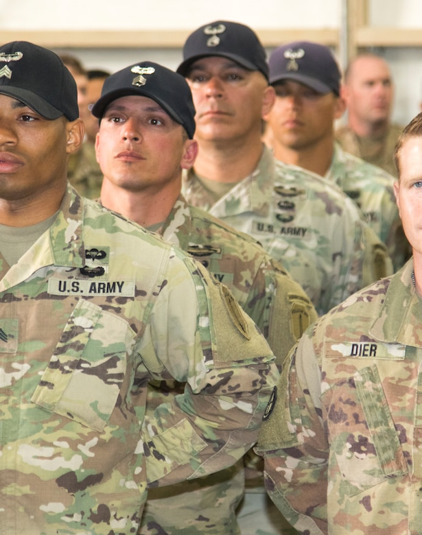 """Army Staff Sgt. William Ramos, second from left, and Staff Sgt. Thomas Presutti, behind Ramos, both air assault instructors assigned to the Army National Guard Warrior Training Center, Fort Benning, Georgia, stand in formation with their graduating students Feb. 15, 2019, at Camp Buehring, Kuwait. Service members were offered an opportunity to attend the rigorous school to develop additional skills, including moving equipment and rappelling, while deployed in a combat environment. """"You're setting a Soldier up to be successful in a combat environment,"""" said Ramos."""