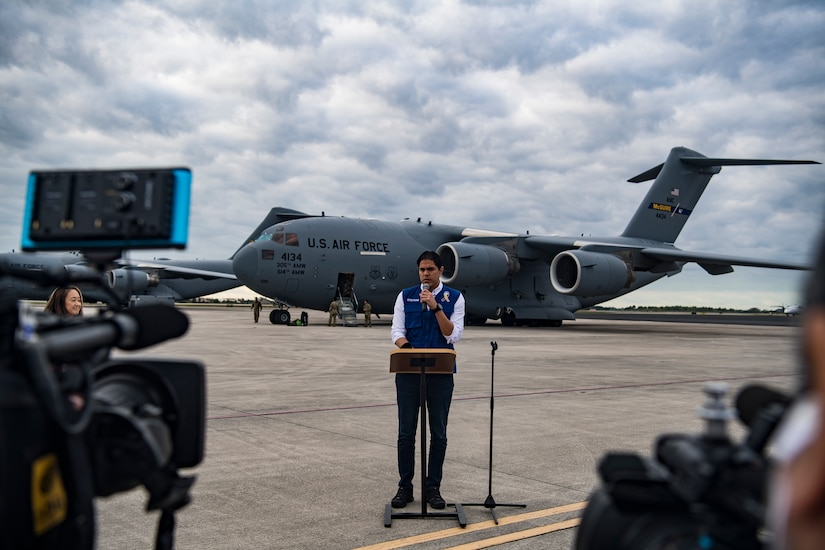Lester Toledo, a representative of the interim government of Venezuela, gives a press conference in front of A C-17 Globemaster III before delivering humanitarian aid from Homestead Air Reserve Base, FL to Cucuta, Colombia February 16, 2019.
