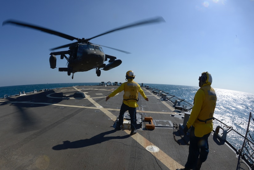 Aviators with the Minnesota, Texas and Utah National Guards, led by the Kansas National Guard's 1st Battalion, 108th Aviation Regiment, practice landing and taking off during deck landing qualification training aboard the Arleigh Burke-class guided-missile destroyer USS Mitscher (DDG 57) in the Arabian Gulf on Feb. 4, 2019.