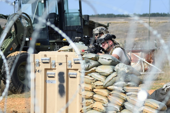 Contingency Response Forces assigned to the 821st Contingency Response Group out of Travis Air Force Base, Calif., secure the perimeter around the Geronimo Landing Zone during a mission in support of Green Flag Little Rock exercise, Feb. 14, 2019, Fort Polk, La. The primary objective of the exercise is to support the Joint Readiness Training Center and provide the maximum number of airlift crews, mission planners and ground support elements to a simulated combat environment with emphasis on joint force integration. (U.S. Air Force photo by Tech. Sgt. Liliana Moreno)