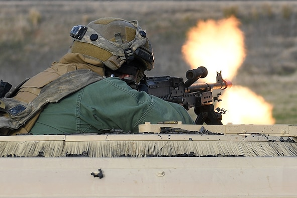 Staff Sgt. Keith Keiffer, 921st Contingency Response Squadron security forces, fires the M240B machine gun in response to a simulated gunfire attack at the Geronimo Landing Zone during a mission in support of Green Flag Little Rock exercise, Feb. 14, 2019, Fort Polk, La. The primary objective of the exercise is to support the Joint Readiness Training Center and provide the maximum number of airlift crews, mission planners and ground support elements to a simulated combat environment with emphasis on joint force integration. (U.S. Air Force photo by Tech. Sgt. Liliana Moreno)