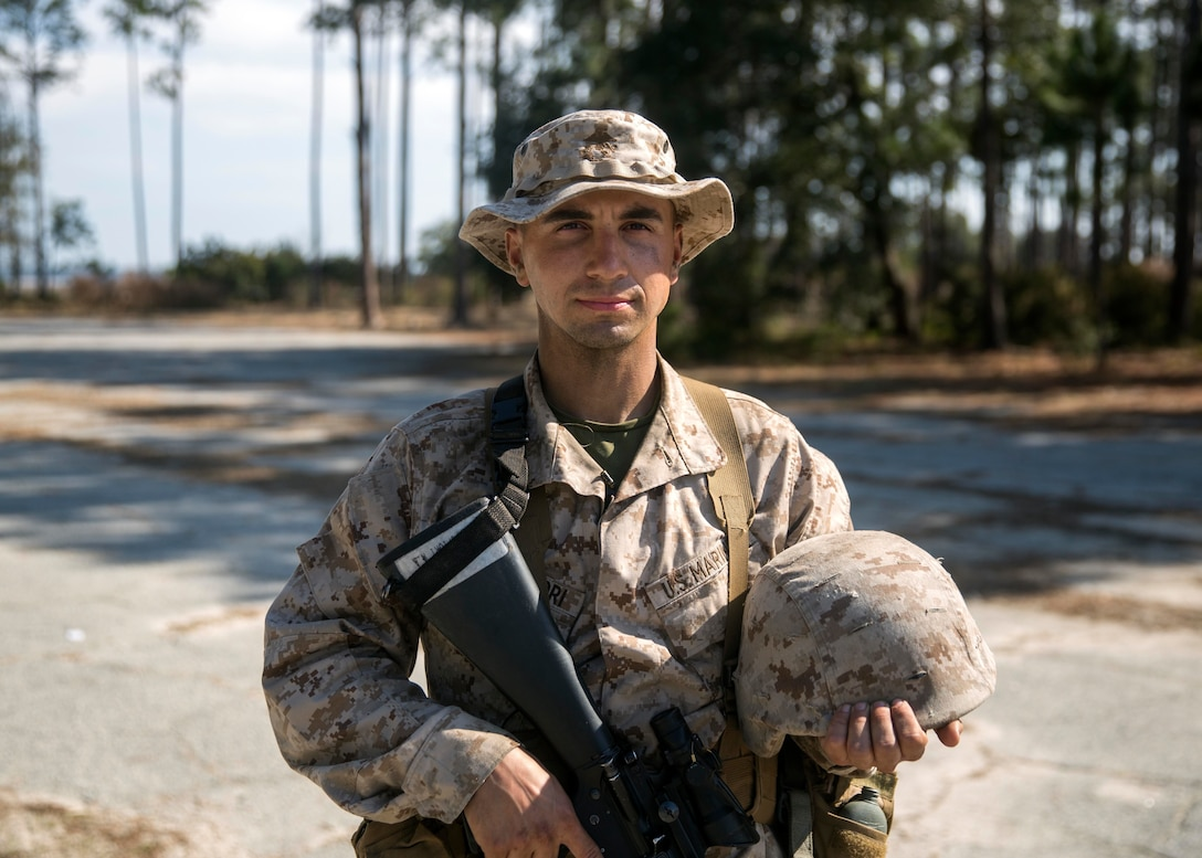 Michael Campofiori, a recruit with Platoon 2020, Company E, 2nd Recruit Training Battalion, Recruit Training Regiment, poses for a photo before participating in the Day Movement Course as part of Basic Warrior Training at Marine Corps Recruit Depot Parris Island, South Carolina, Feb. 6, 2019. Campofiori, a native of Brick Township, New Jersey, overcame Leukemia and is now pursuing a career in the Marine Corps. BWT is a week-long training event that helps teach recruits the basic of combat survival and advanced rifle maneuvers. (U.S. Marine Corps photo by Lance Cpl. Jack A. E. Rigsby)