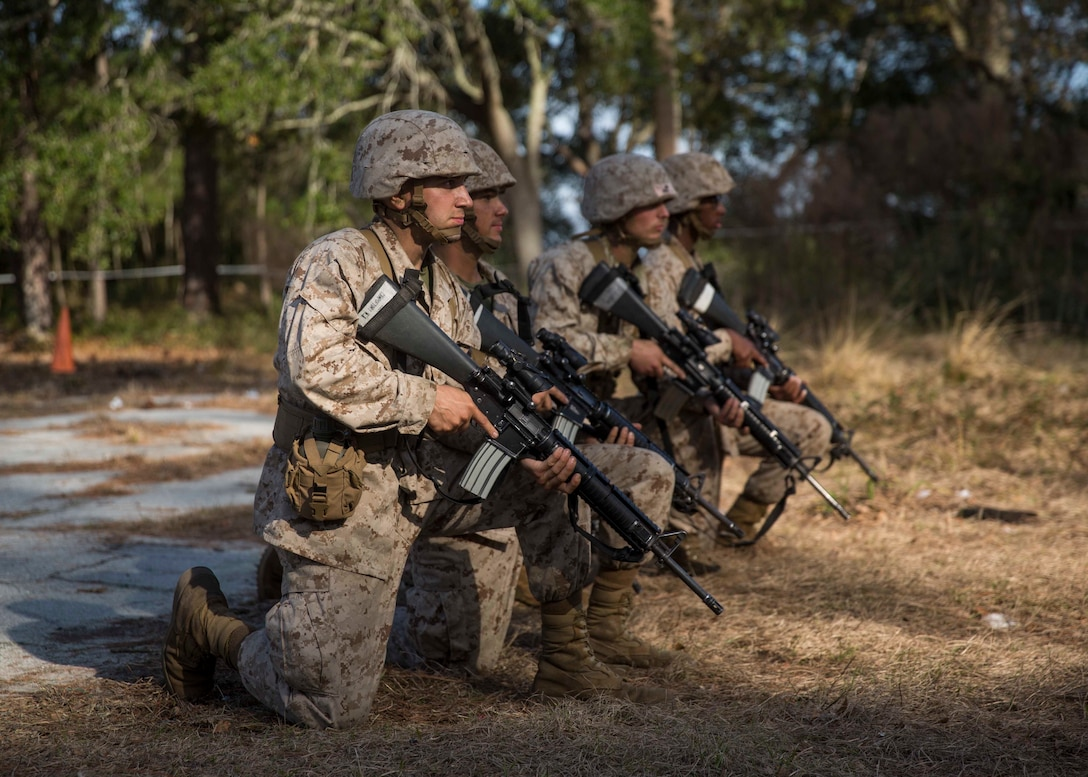 Michael Campofiori, a recruit with Platoon 2020, Company E, 2nd Recruit Training Battalion, Recruit Training Regiment, and his fellow recruits await the command to begin the Day Movement Course as part of Basic Warrior Training at Marine Corps Recruit Depot Parris Island, South Carolina, Feb. 6, 2019. Campofiori, a native of Brick Township, New Jersey, overcame Leukemia and is now pursuing a career in the Marine Corps. BWT is a week-long training event that helps teach recruits the basics of combat survival and advanced rifle maneuvers. (U.S. Marine Corps photo by Lance Cpl. Jack A. E. Rigsby)
