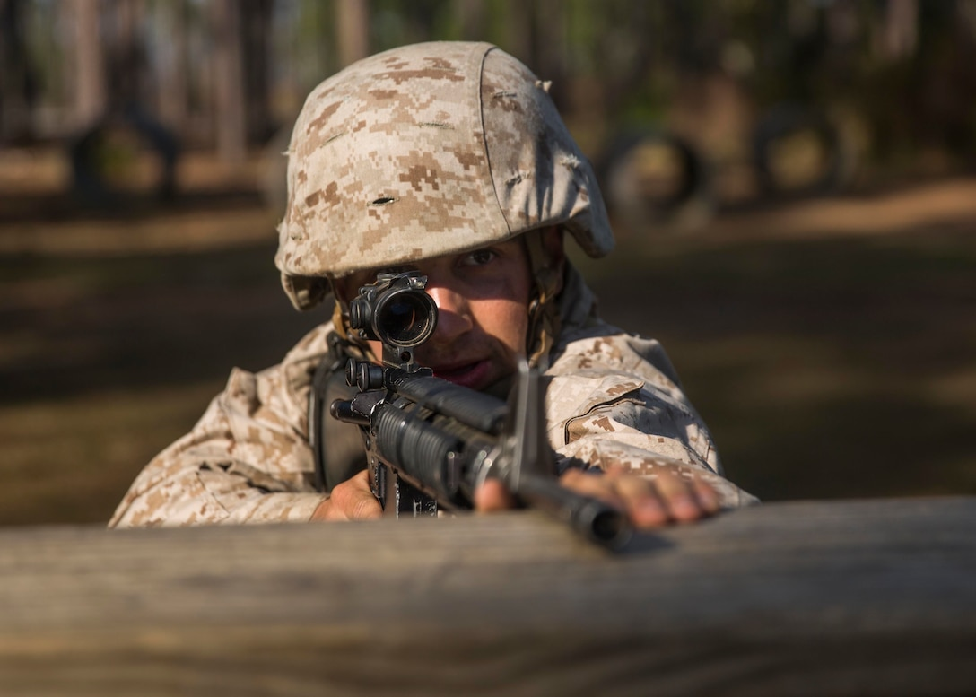 Michael Campofiori, a recruit with Platoon 2020, Company E, 2nd Recruit Training Battalion, Recruit Training Regiment, participates in the Day Movement Course as part of Basic Warrior Training at Marine Corps Recruit Depot Parris Island, South Carolina, Feb. 6, 2019. Campofiori, a native of Brick Township, New Jersey, overcame Leukemia and is now pursuing a career in the Marine Corps. BWT is a week-long training event that helps teach recruits the basics of combat survival and advanced rifle maneuvers. (U.S. Marine Corps photo by Lance Cpl. Jack A. E. Rigsby)