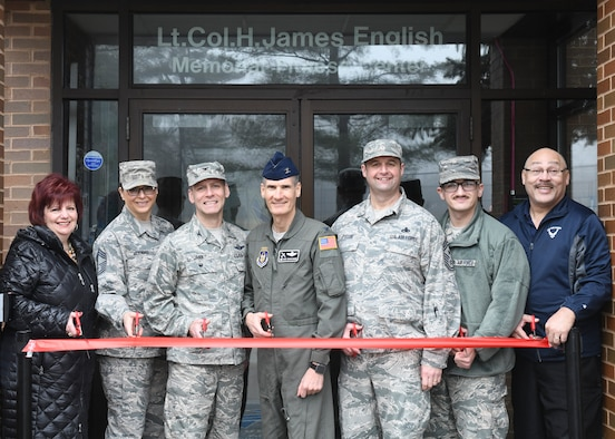 The 910th Airlift Wing's leadership and fitness center representatives cut a ribbon marking the fitness center's new 24-hour access feature, at Youngstown Air Reserve Station, Feb. 7, 2019. The feature was added to be current with other Air Force bases.