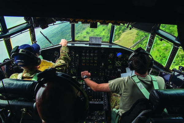 In September 2018, U.S. C–130 Hercules pilots conduct low altitude flying maneuvers over Colombia during the Colombian-led search and rescue exercise Angel de los Andes. (U.S. Air Force/ Angela Ruiz)