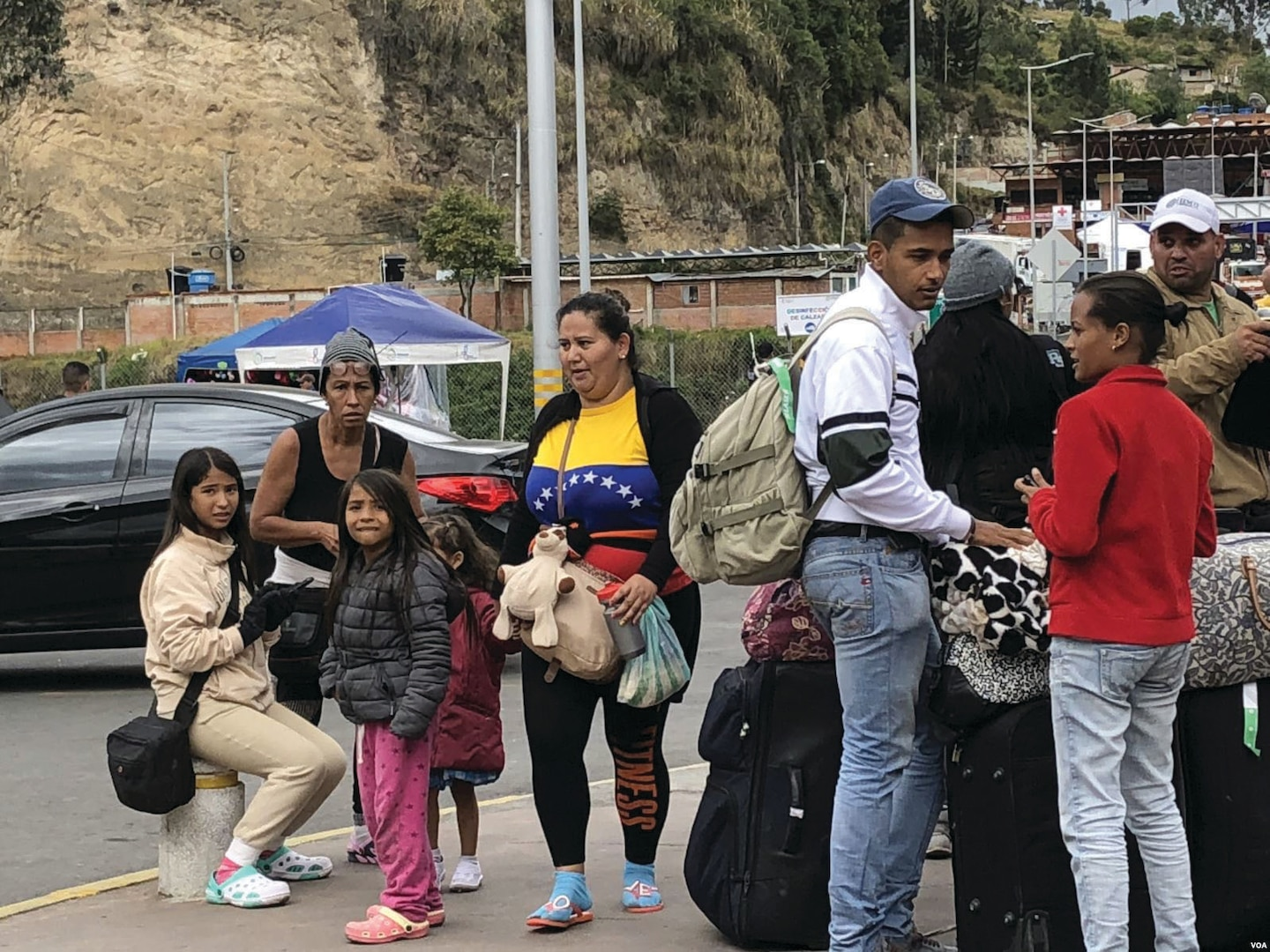 Venezuelans cross the border between Ecuador and Colombia in search of new opportunities.