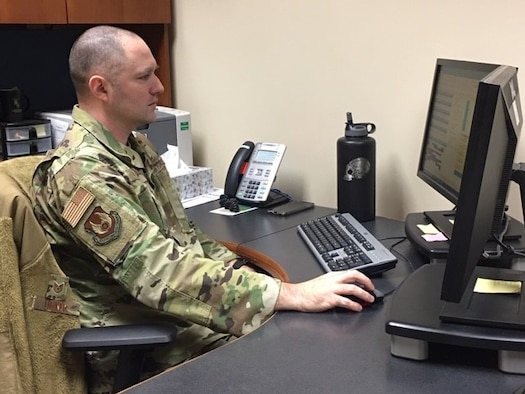 Tech. Sgt. Gregory Linker, Military Personnel Flight section chief, Career Development, observes permanent change of station processing practices, percentages and customer service data to make processes lean and timely.