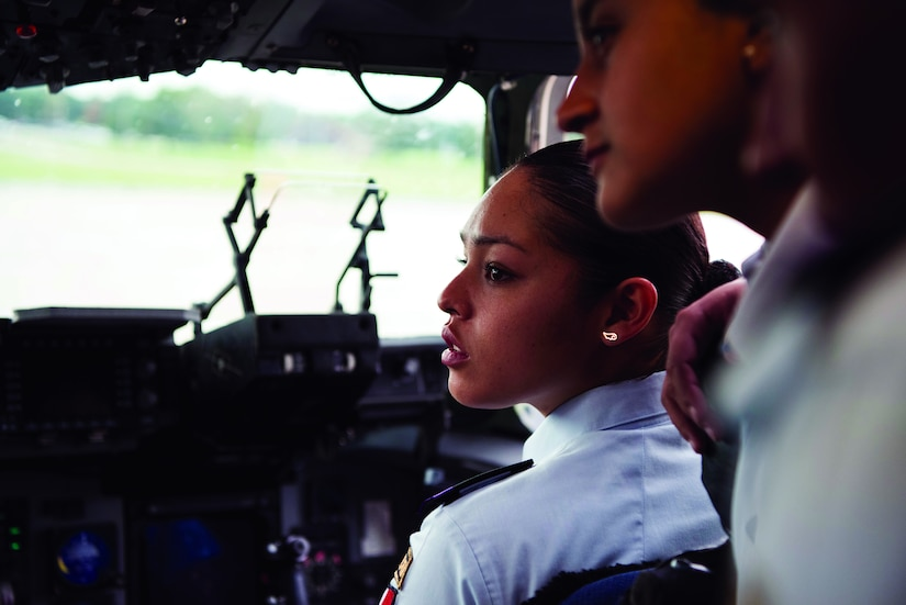 Karina Chavez Munoz, a cadet from the Mexican Air Force Academy, sits in the copilot seat on a C-17 Globemaster III Oct. 15, 2018, at Dover Air Force Base, Del. During their tour of Dover the cadets had lunch at Patterson Dining Facility and got to experience the C-17 and C-5M Super Galaxy up close. (U.S. Air Force photo by Airman 1st Class Zoe M. Wockenfuss181015-F-OK627-1086