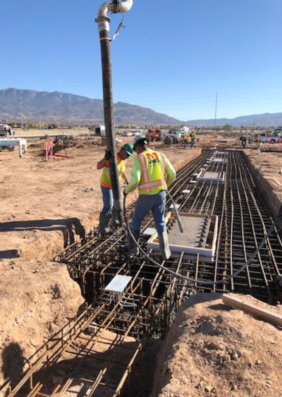 Workers pour footings for the new NNSA building, Oct. 1, 2018.