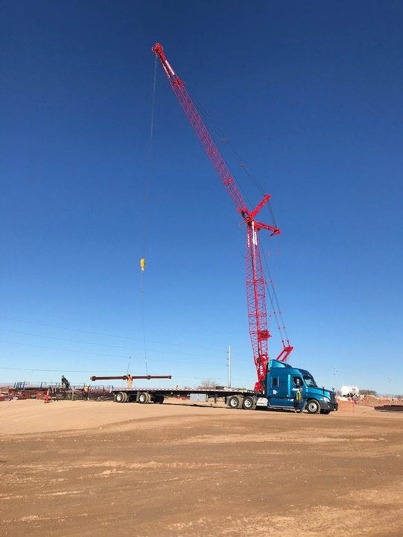 Steel girders are unloaded by crane at the NNSA Albuquerque Complex site, Dec. 19, 2018.
