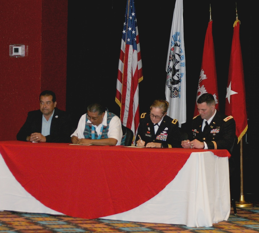During a Santa Clara Pueblo partnership meeting, (l-r): Santa Clara Lt. Gov. James Naranjo; Santa Clara Gov. J. Michael Chavarria; USACE South Pacific Division commander Brig. Gen. Kimberly Colloton; and USACE Albuquerque District commander Lt. Col. Larry Caswell sign the Watershed Management Plan Proclamation, Nov. 30, 2018, at the Santa Claran Hotel Event Center.