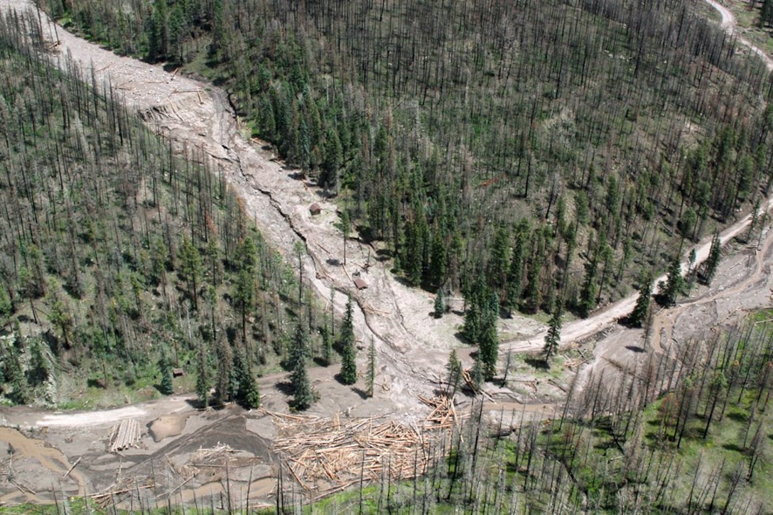 Post-fire condition of the Santa Clara Creek Canyon watershed. The existing watershed resources (soils, forest canopy, water quality, etc.) have been negatively impacted by wild-fires, which has increased the potential for catastrophic flooding events to occur.