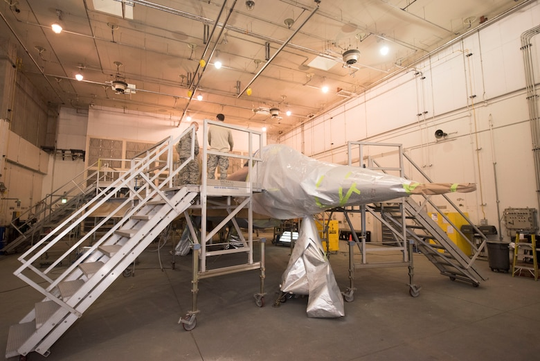 A U.S. Air Force F-16 Fighting Falcon receives a repaint from the Airmen with the 35th Maintenance Squadron at Misawa Air Base, Japan, Jan. 29, 2019. The aircraft underwent a repaint to extend its service life and maintain combat air power. This jet will be the premier, ceremonial aircraft for the 5th Air Force commander.  (U.S. Air Force photo by 1st Lt. Jeremy Garcia)