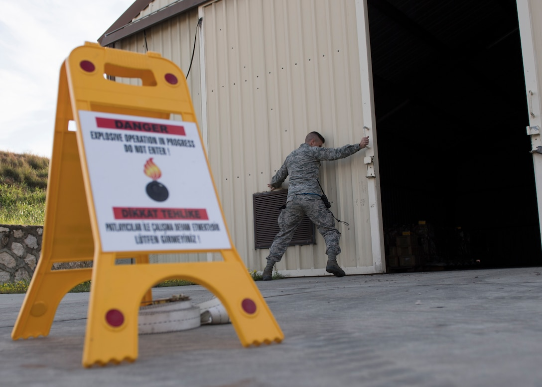 U.S. Air Force Staff Sgt. Matthew Olson, 39th Maintenance Squadron stockpile management production supervisor, closes the door to a munitions storage unit Jan. 31, 2019, at Incirlik Air Base, Turkey.