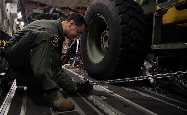 Staff Sgt. Travis Perry, a C-17 Globemaster III loadmaster with the 6th Airlift Squadron, prepares cargo while supporting a humanitarian mission Cucuta, Colombia, Feb. 16. This mission was planned at the request of the U.S. Secretary of State, in close coordination with USAID and with the approval of the government of Colombia. The role of the U.S. military during this peaceful mission is to transport urgently needed aid to Colombia for eventual distribution by relief organizations on the ground for Venezuelans impacted by the rapidly deteriorating crisis in their country. This humanitarian mission underscores the United States' firm commitment and readiness to respond to the man-made political, economic, and humanitarian crisis in Venezuela. (U.S. Air Force Photo by Tech. Sgt. Gregory Brook)