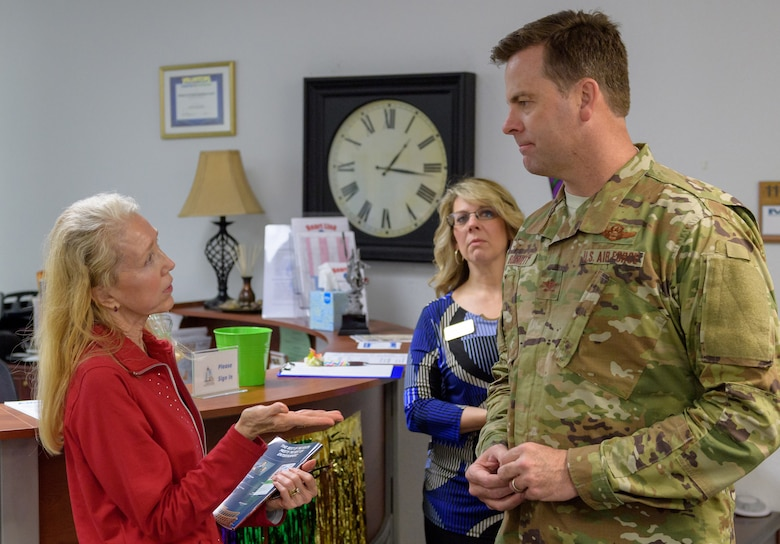 Mary Buckley, daughter of U.S. Air Force Capt. Robert Gereer, gives her thanks to Col. Lance Burnett, 81st Training Wing vice commander, for her Gold Star Family Member ID card as Holly Fisher, 81st Force Support Squadron Airman & Family Readiness Center community readiness specialist, (center), observes inside the Sablich Center at Keesler Air Force Base, Mississippi, Feb. 15, 2019. Gereer served during the Korean War and was placed in a missing in action (MIA) status due to his remains not being found. As a surviving daughter of an MIA service member, Buckley is allowed to obtain an ID card for recognition and installation access so that she can attend events and access A&FRC referral services. (U.S. Air Force photo by Andre' Askew)