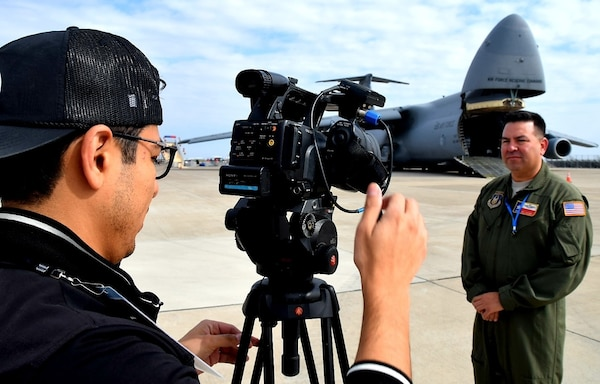 Master Sgt. Guillermo Jalomo, 68th Airlift Squadron loadmaster, prepares for an interivew with a local television station at the Laredo International Airport in Laredo, Texas Feb. 17, 2019. Jalomo, a Laredo United High School graduate, was part of the aircrew that flew the 433rd Airlift Wing's C-5M Super Galaxy from Joint Base San Antonio-Lackland to the Washington's Birthday Celebration Association Stars and Stripes Air Show Spectacular.