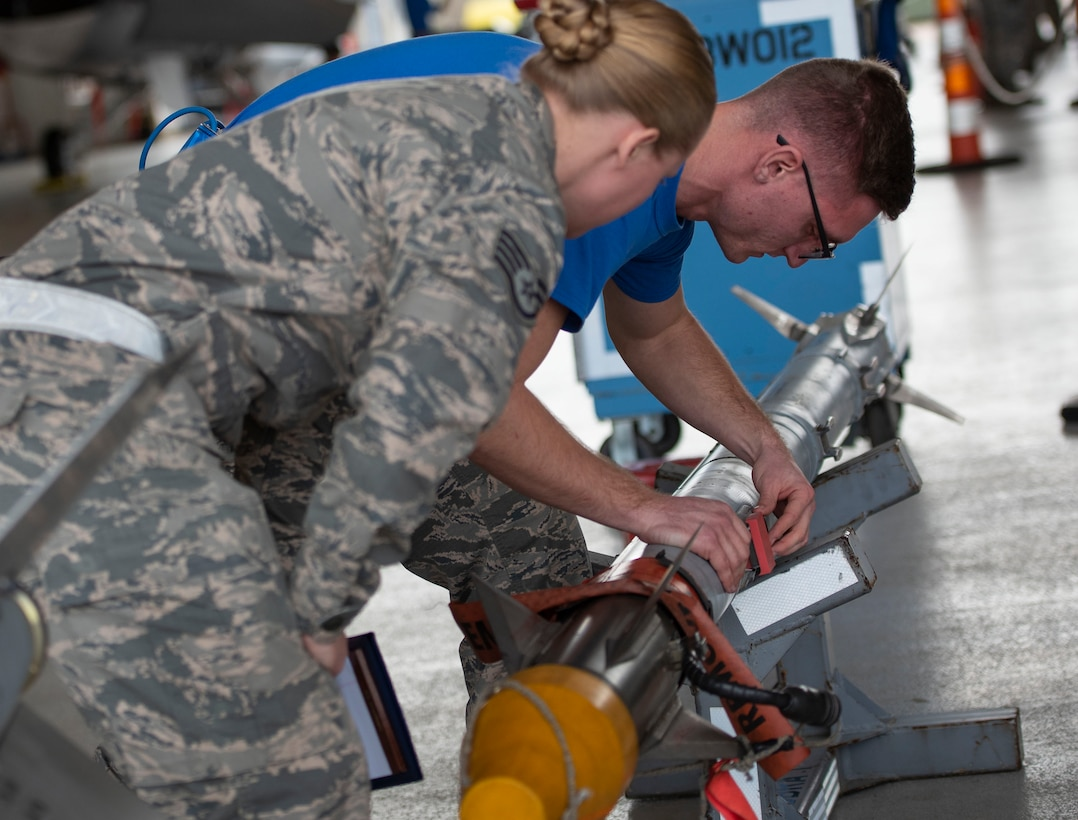 96th Aircraft Maintenance Squadron load crews compete during the annual weapons load competition for the title of Best Load Crew Of The Year. The fast-paced competition tests the knowledge and proficiency of the Airmen. The winning load crew is scheduled to be announced at the Maintenance Professionals of the Year Banquet in March.