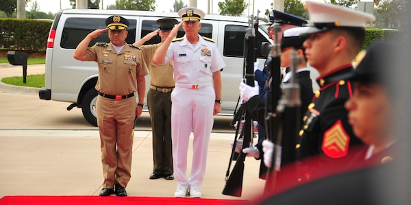 U.S. Navy Adm. Craig Faller, commander of U.S. Southern Command, and Colombian Army Maj. Gen. Luis Navarro Jiménez, Commanding General of the Colombian Military Forces, render honors at SOUTHCOM headquarters.