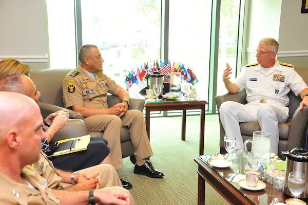 U.S. Navy Adm. Craig Faller, commander of U.S. Southern Command, and Colombian Army Maj. Gen. Luis Navarro Jiménez, Commanding General of the Colombian Military Forces, talk at SOUTHCOM headquarters.