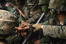U.S. and Thai marines group together before an exercise.