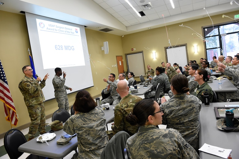 628th Medical Group Airmen celebrate winning the U.S. Air Force Surgeon General Award for Clinic of the Year Feb. 20, 2019, during a commander's call at Joint Base Charleston, S.C.