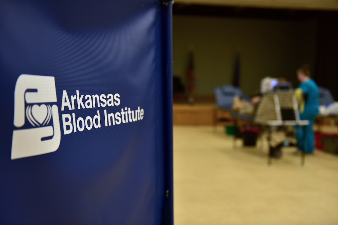 "There is a blue sign that reads ""Arkansas Blood Institute."""
