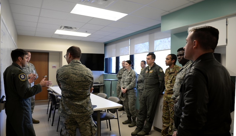 Airmen from the 552nd Air Control Wing at Tinker Air Force Base, Oklahoma, tour the Koritz Clinic with Capt. Scott Mckeithen, 14th Medical Group practice manager, and Maj. Ryan Brewer, 14th Flying Training Wing director of innovation, Feb. 13, 2018, on Columbus AFB, Mississippi. They visited areas in the 14th MDG to see how the Columbus AFB Spark Cell has aided in projects utilizing innovation for faster and better daily operations. (U.S. Air Force photo by Airman Hannah Bean)