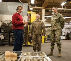 """Harold """"Edward"""" Flinn, Director, Advanced Manufacturing, RIA-JMTC, discusses 3D printing capabilities to Chief Warrant Officer 5 Steven Dewey, Maintenance Chief, 1st TSC; Lt. Col. Mike Mai, Assistant Chief of Staff for the G-8, 1st TSC while touring the foundry at RIA-JMTC."""