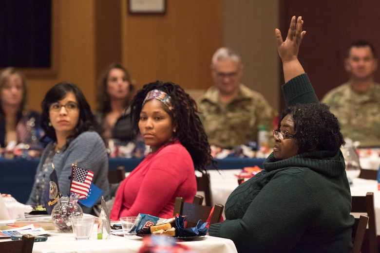 """Attendees ask questions during a military spouse town hall and luncheon at Joint Base Elmendorf-Richardson, Alaska, Feb. 12, 2019. The Military and Family Readiness Center-hosted event had more than 120 attendees with the theme """"Taking Care of People."""""""