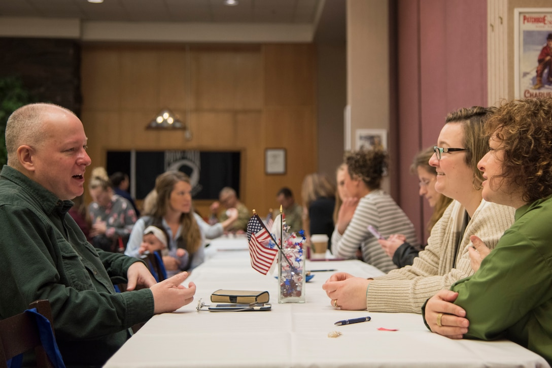 "Attendees sign in during a military spouse town hall and luncheon at Joint Base Elmendorf-Richardson, Alaska, Feb. 12, 2019. The Military and Family Readiness Center-hosted event had more than 120 attendees with the theme ""Taking Care of People."""