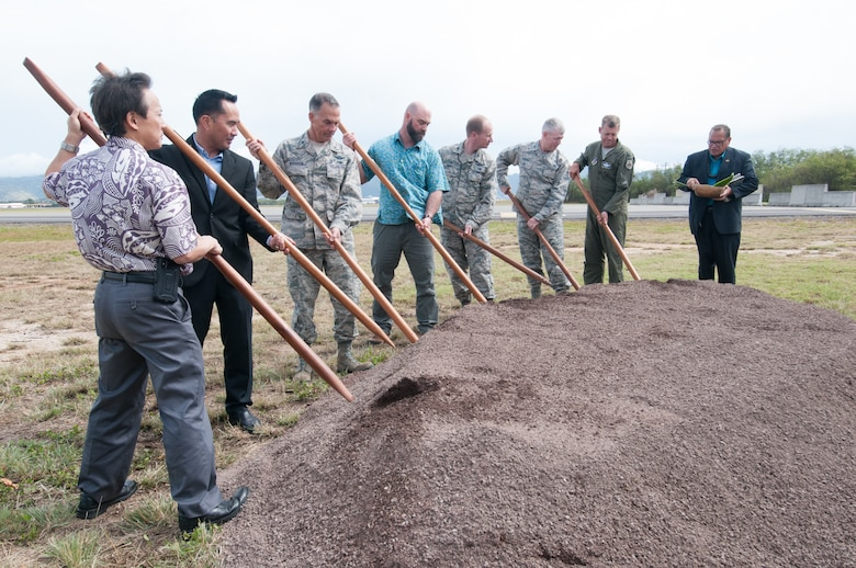 Representatives from Pacific Air Forces, 154th Wing, 15th Wing, Air Force Civil Engineer Center, and the United States Army Corps of Engineers participate in a ground-breaking ceremony for the new F-22 Aerospace Control Alert Facility.