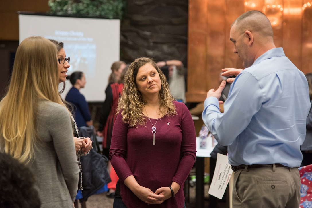 "Attendees talk to one another during a military spouse town hall and luncheon at Joint Base Elmendorf-Richardson, Alaska, Feb. 12, 2019. The Military and Family Readiness Center-hosted event had more than 120 attendees with the theme ""Taking Care of People."""