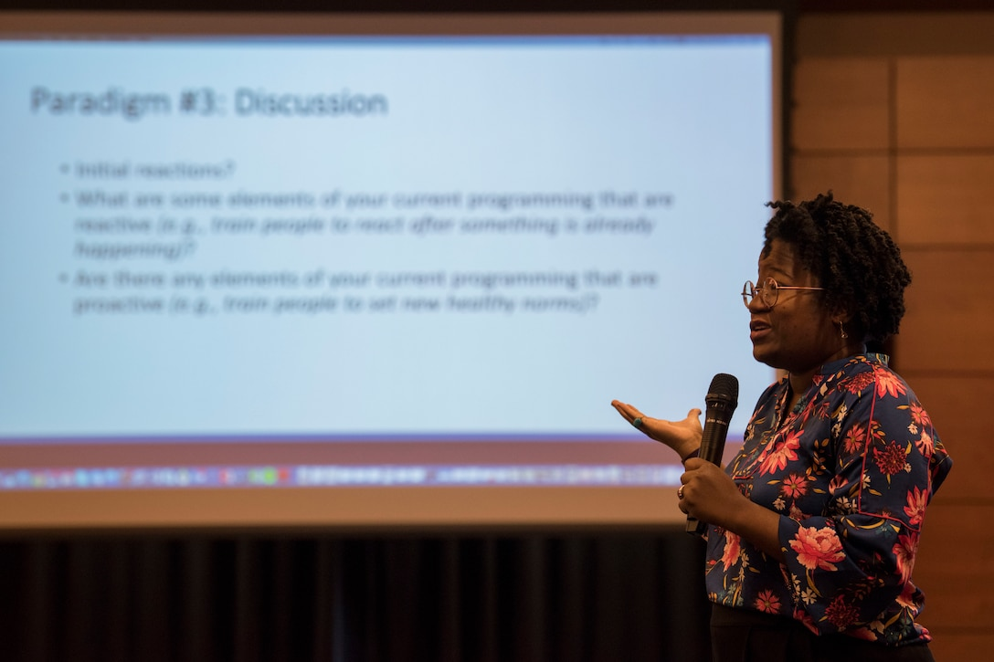 Sirajah Raheem, an Alteristic technical assistance specialist and senior trainer, speaks during a solution-driven Green Dot violence prevention seminar at Joint Base Elmendorf-Richardson, Alaska, Feb. 14, 2019. Since 2016, Green Dot facilitators across the Air Force have trained Airmen on what it means to be a bystander and steps they can take when issues arise, with the goal being to reduce or prevent sexual assault and violence. Beginning in January 2019, the Joint Installation Prevention Team shifted its focus from response to prevention when it comes to families in crisis.
