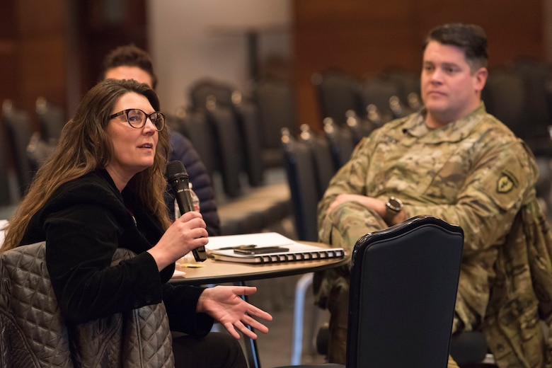 Jill Meszaros, an Airmen and Family Readiness program manager for the 176th Wing Alaska National Guard, speaks during a solution-driven Green Dot violence prevention seminar at Joint Base Elmendorf-Richardson, Alaska, Feb. 14, 2019. Beginning in January 2019, the Joint Installation Prevention Team shifted its focus from response to prevention when it comes to families in crisis.