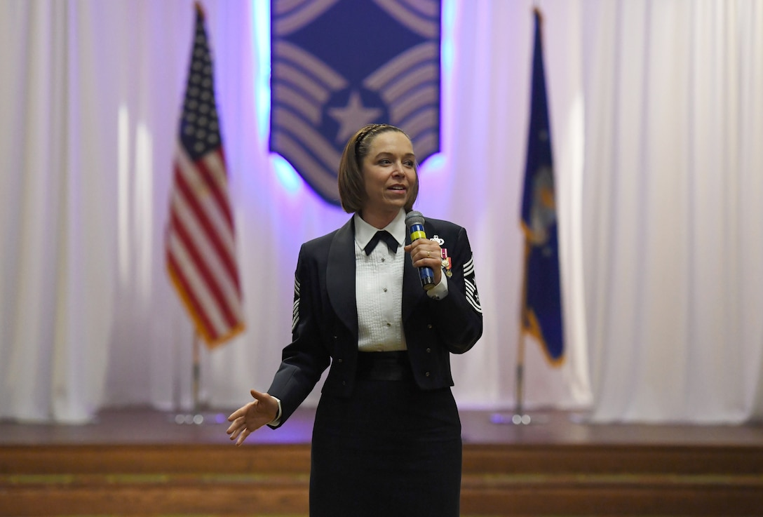 U.S. Air Force Chief Master Sgt. Juliet Gudgel, Air Education and Training Command command chief, delivers remarks as the event guest speaker during the Chief Induction Ceremony inside the Bay Breeze Event Center at Keesler Air Force Base, Mississippi, Feb. 15, 2019. Five Keesler Airmen earned their chief master sergeant stripe during the 2019 promotion release. Air Force officials selected 479 senior master sergeants for promotion to chief master sergeant out of 2,241 eligible for a selection rate of 21.37 percent. Chief master sergeants make up one percent of the Air Force enlisted force. (U.S. Air Force photo by Kemberly Groue)