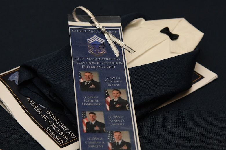 Event memento book marks and tuxedo napkins are displayed during the Chief Induction Ceremony inside the Bay Breeze Event Center at Keesler Air Force Base, Mississippi, Feb. 15, 2019. Five Keesler Airmen earned their chief master sergeant stripe during the 2019 promotion release. Air Force officials selected 479 senior master sergeants for promotion to chief master sergeant out of 2,241 eligible for a selection rate of 21.37 percent. Chief master sergeants make up one percent of the Air Force enlisted force. (U.S. Air Force photo by Kemberly Groue)