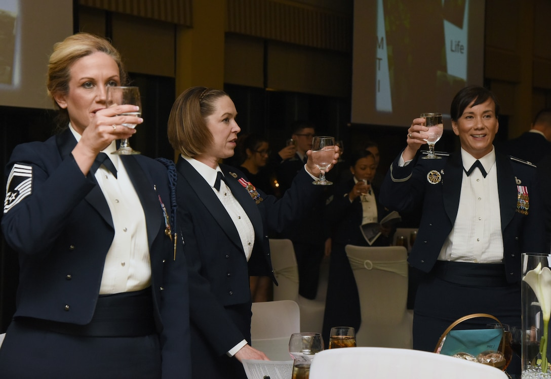 U.S. Air Force Chief Master Sgt. Alucia Davis, 2nd Air Force military training career field manager; Chief Master Sgt. Juliet Gudgel, Air Education and Training Command command chief, and Col. Debra Lovette, 81st Training Wing commander, offer a toast during the Chief Induction Ceremony inside the Bay Breeze Event Center at Keesler Air Force Base, Mississippi, Feb. 15, 2019. Five Keesler Airmen earned their chief master sergeant stripe during the 2019 promotion release. Air Force officials selected 479 senior master sergeants for promotion to chief master sergeant out of 2,241 eligible for a selection rate of 21.37 percent. Chief master sergeants make up one percent of the Air Force enlisted force. (U.S. Air Force photo by Kemberly Groue)