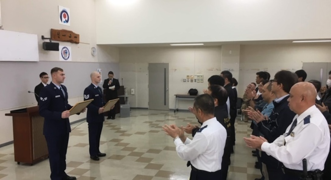 Senior Airman Justin Kannenberg and Tech. Sgt. Argo Cesareo, both, aircraft recovery for the 18th Equipment Maintenance Squadron, were recognized by the Uruma Police Station in Uruma City, Japan, Jan. 28, 2019, for putting out a local fire. The Airmen saw the fire on their way to dinner and immediately took action until emergency services arrived.
