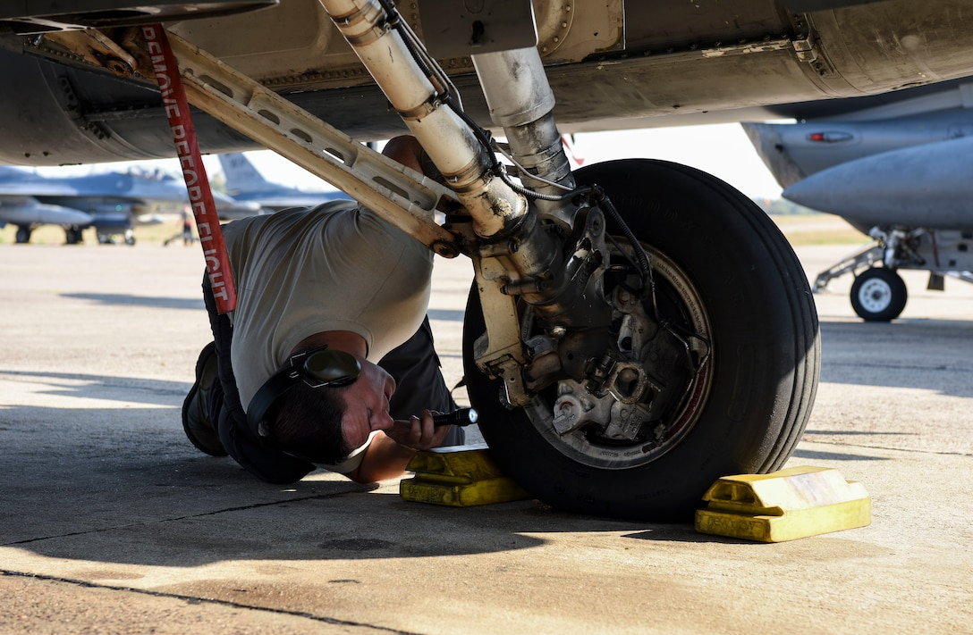 U.S. Air Force Staff Sgt. Travis Davis, 8th Aircraft Maintenance Squadron crew chief, inspects a USAF F-16 Fighting Falcon brake during Exercise Cobra Gold 2019 at Korat Royal Thai Air Force Base, Thailand, Feb. 19, 2019. Cobra Gold provides a venue for both U.S. and partner nations to advance interoperability and increase partner capacity in planning and executing complex and realistic multinational force and combined task force operations. (U.S. Air Force photo by Senior Airman Savannah L. Waters)