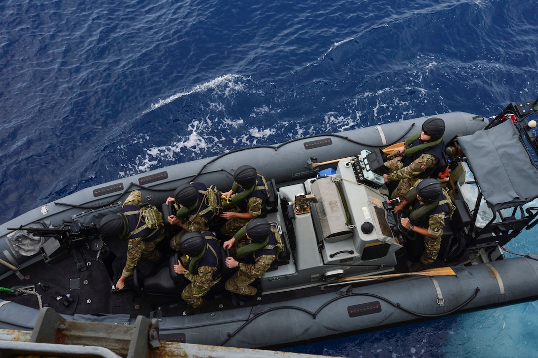 GULF OF THAILAND (Feb. 18, 2019) - Royal Marine commandos and Royal Navy sailors attached to the Duke-class frigate HMS Montrose (F 236), conduct a visit, board, search and seizure (VBSS) drill aboard the Henry J. Kaiser-class fleet underway replenishment oiler USNS Guadalupe (T-AO 200).
