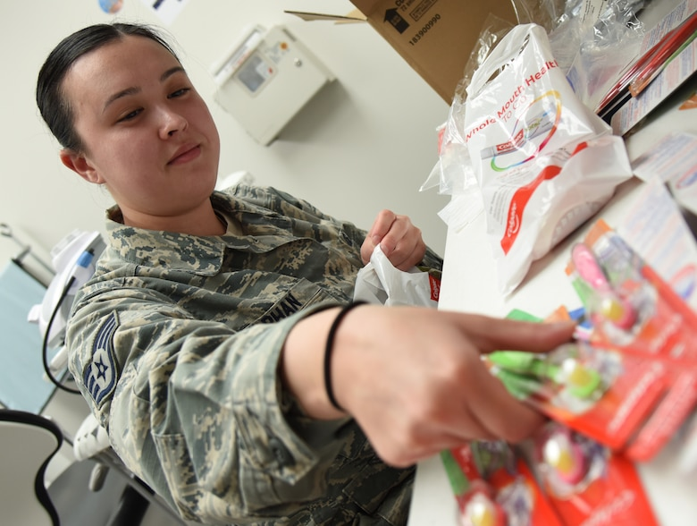 U.S. Air Force Staff Sgt. Iva Phan, 81st Dental Squadron dental assistant, places toothbrushes in bags for military children during the 9th Annual Give Kids a Smile Day at the dental clinic inside the Keesler Medical Center at Keesler Air Force Base, Mississippi, Feb. 15, 2019. The event was held in recognition of National Children's Dental Health Month and included free dental exams, radiographs, and cleanings for children age two and older. (U.S. Air Force photo by Kemberly Groue)