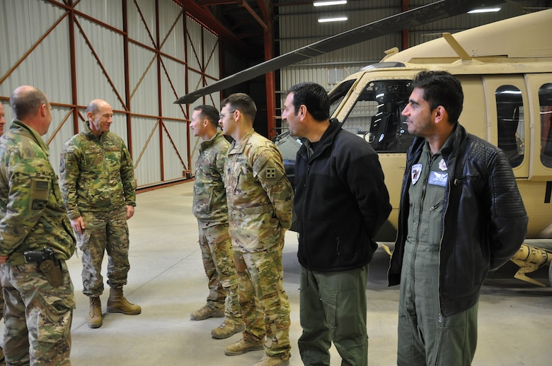 Gen. Mike Holmes, commander of Air Combat Command, meets Train Advise Assist Command-Air and Afghan Air Force personnel during a visit to Kandahar Airfield, Afghanistan, Feb. 13, 2019.