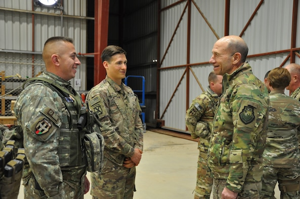 Gen. Mike Holmes, commander of Air Combat Command, greets a Romanian soldier during a visit to Kandahar Airfield, Afghanistan, Feb. 13, 2019.
